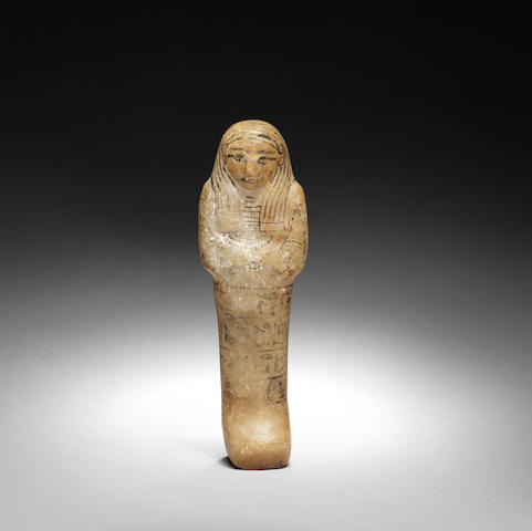 An Egyptian alabaster shabti