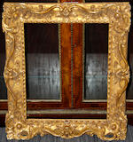 An English mid 18th Century carved, pierced and gilded frame