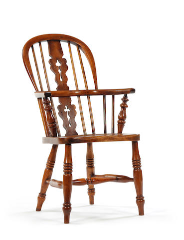 A 19th century child's yew, ash and elm Windsor armchair