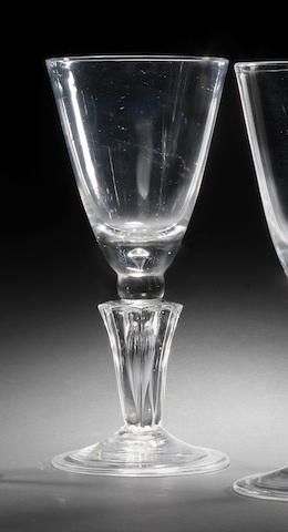 A baluster goblet with panel-moulded stem, the glass circa 1715, the bowl dated 1718