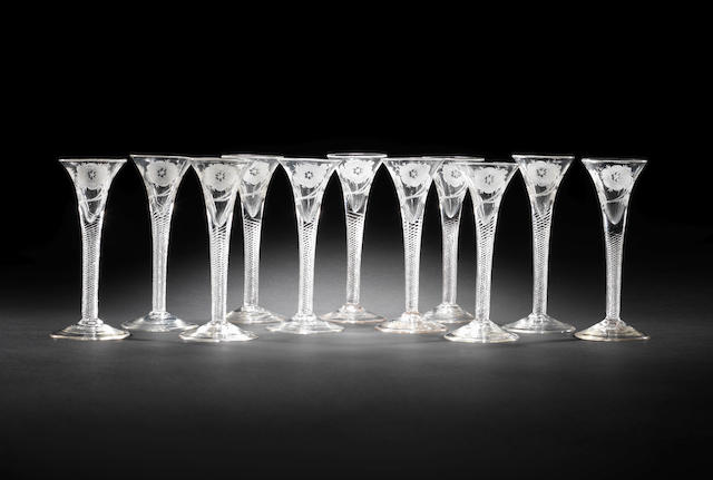 A remarkable set of eleven engraved Jacobite wine glasses, circa 1745-55