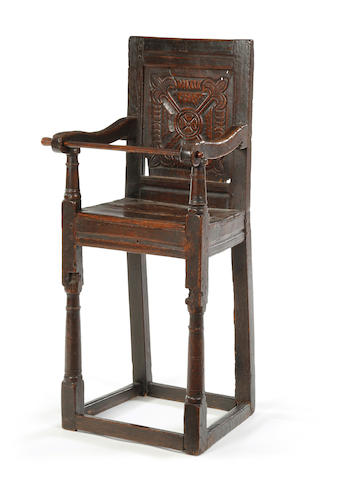 A Charles II oak child's highchair
