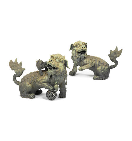 A pair of rare and impressive bronze Buddhist lions Mid Qing Dynasty