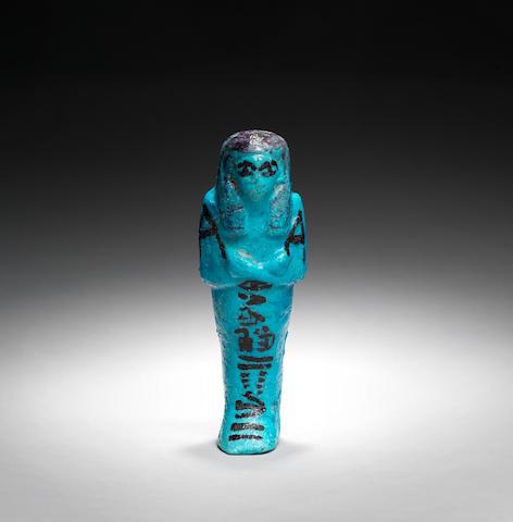 An Egyptian bright blue glazed shabti