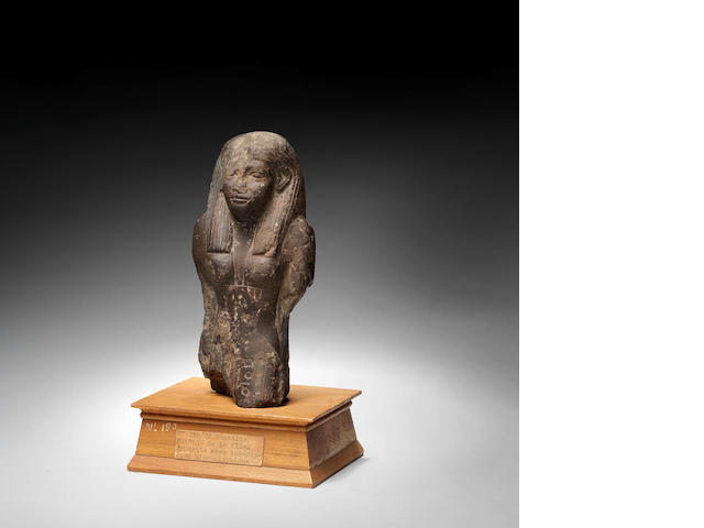 A Egyptian haematite statue of a woman