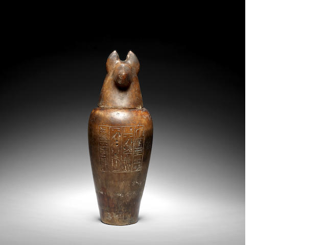 An Egyptian alabaster canopic jar with stopper