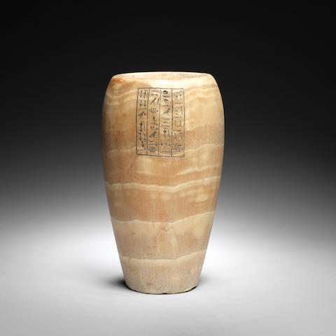 An Egyptian banded alabaster canopic jar
