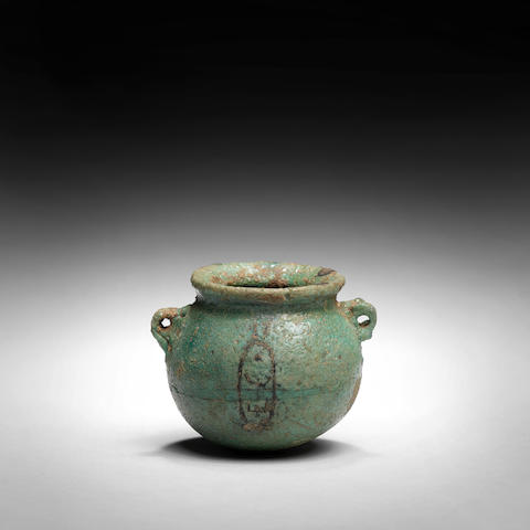 A small Egyptian green glazed composition jar for Amenophis I