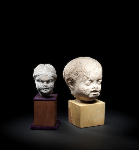 A Roman marble head of a child and a small Roman limestone head  2