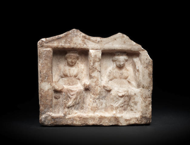 A Greek marble votive double stele