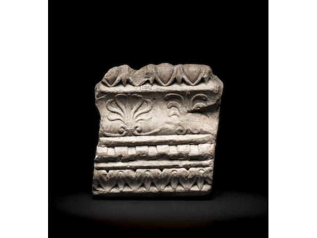 A Roman marble architectural relief fragment