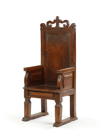 A North Italian walnut panel back enclosed armchair Possibly 16th/17th century