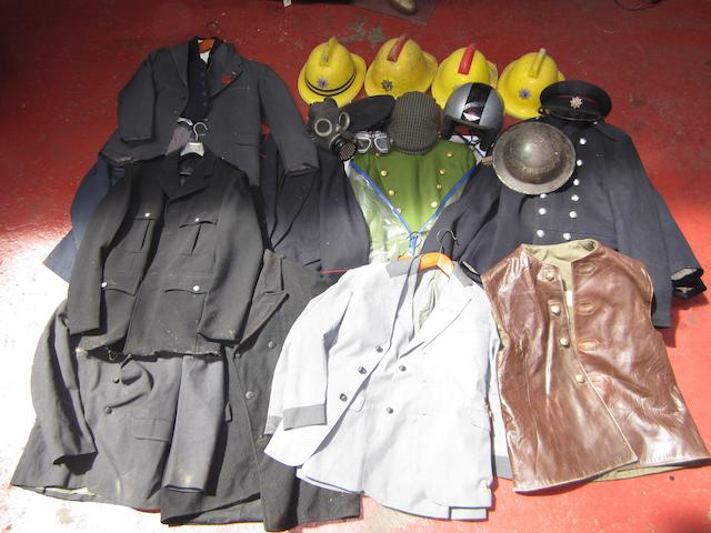 A selection of uniform clothing and headgear,