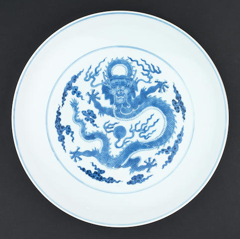 A blue and white 'dragon' saucer dish Qianlong six-character mark