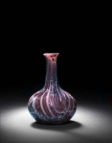 A Roman aubergine marbled glass flask