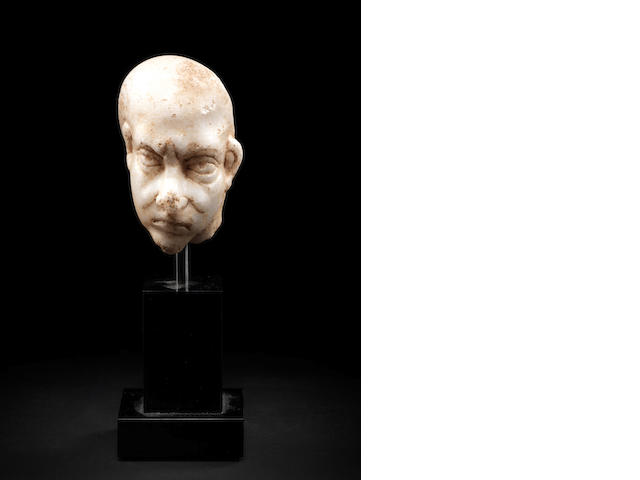 A Roman marble head of a grotesque