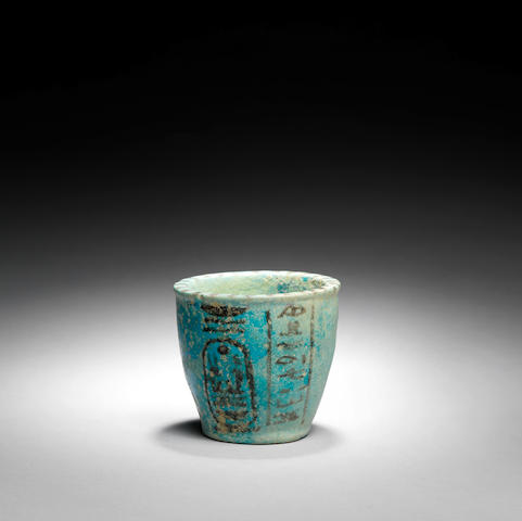 An Egyptian blue glazed composition offering cup