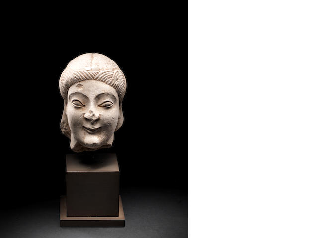 A Cypriot limestone head of a youth