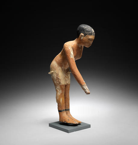 An Egyptian wood servant figure