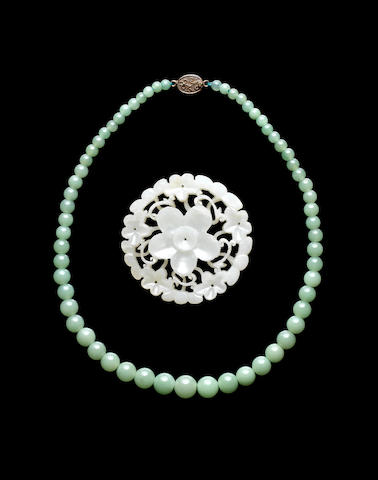 A jade, or other, beaded necklace and a green jade applique