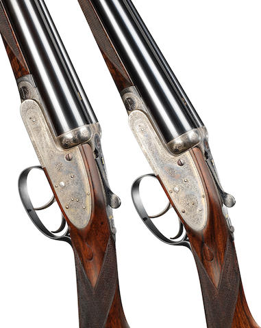 A pair of 12-bore self-opening sidelock ejector guns by J. Purdey & Sons, no. 18648/9 In their brass-mounted oak and leather case with numbered charge sheet listing loads for shot and spherical ball