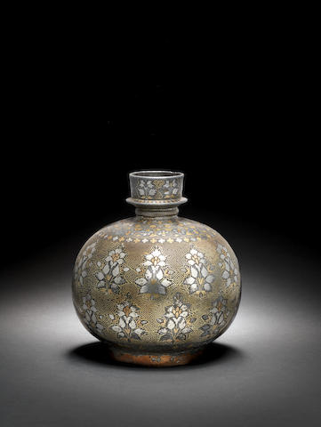 A fine silver and brass inlaid alloy Bidri Huqqa Base Bidar, Deccan, mid 17th Century