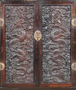 A rare set of Imperial zitan 'dragon' panels 18th/19th century, set within a later cabinet