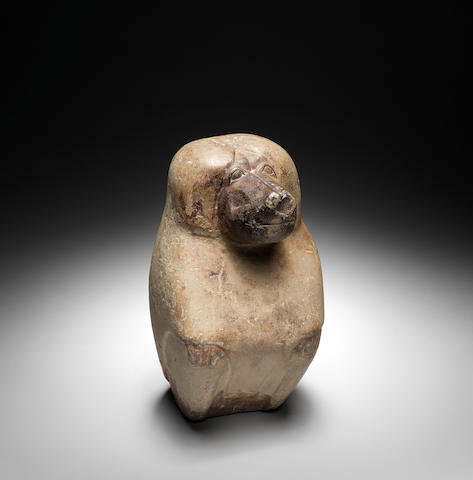 An Egyptian limestone figure of Thoth