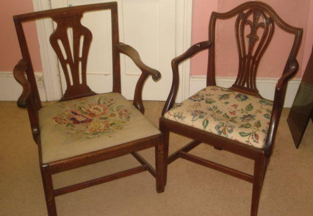 A George III oak framed open elbow chair, having a square back with pierced splat and wool-work drop-in seat, and a mahogany shield back elbow chair. (2)