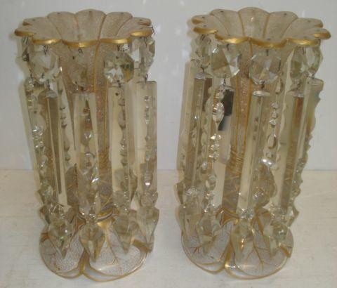 A pair of 19th Century Venetian frosted and gilt line decorated glass lustres, trumpet shape with baluster knop stems on spreading circular white cased and gilded leaf panel circular bases, hung with facet cut and spike shape clear drops, 30cm.