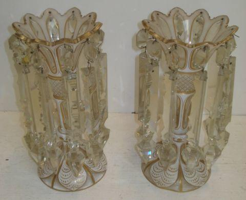 A pair of 19th Century Venetian white cased cut pattern and gilt decorated glass lustres, of trumpet shape, with knop stems and spreading circular bases, hung with facet cut and spike clear drops, 25cm.