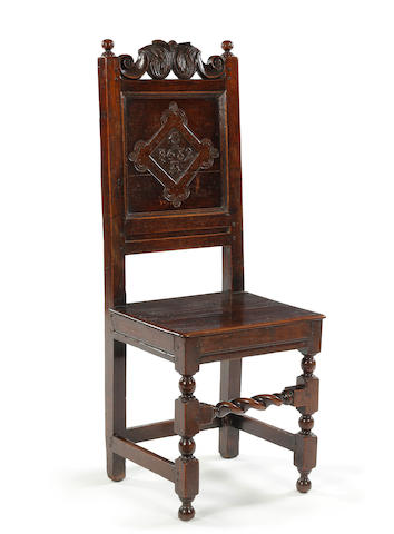 A Charles II oak backstool, dated North Country, possibly Westmorland