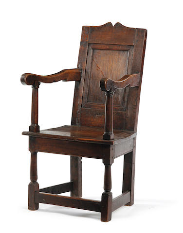 A Charles II oak panel back armchair