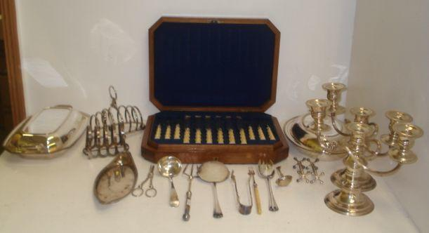 A Victorian figured walnut cased set of twelve pairs of engraved electroplate dessert knives and forks, with rustic bone handles, pair of three light candleabrum, two entree dishes, oval snuffers, tray, two toast racks, grape shears, knife rests, and various flatware.