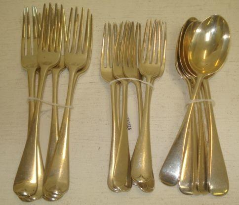 A set of five George III silver Old English pattern table forks, 1795, makers mark rubbed and another 1803, crested and a set of six Edwardian silver Old English pattern dessert spoons and six matching dessert forks, Goldsmiths & Silversmiths Company, 1905, 32ozs. (18)