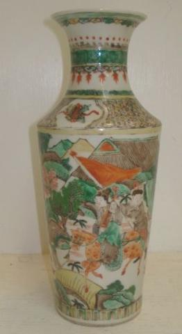 A Chinese 'famille verte' shouldered vase, painted around the sides with figures, and a horse and buildings in a continuous highland landscape, 25cm.