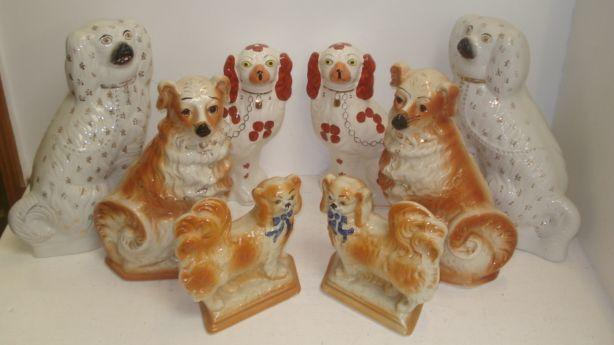 Two pairs of Staffordshire pottery King Charles Spaniel mantel ornaments, 35 & 30cm high respectively, with gilt or rust markings, a pair of Staffordshire pottery Pekinese, Rd No. 542071 and another pair of dogs. (8)