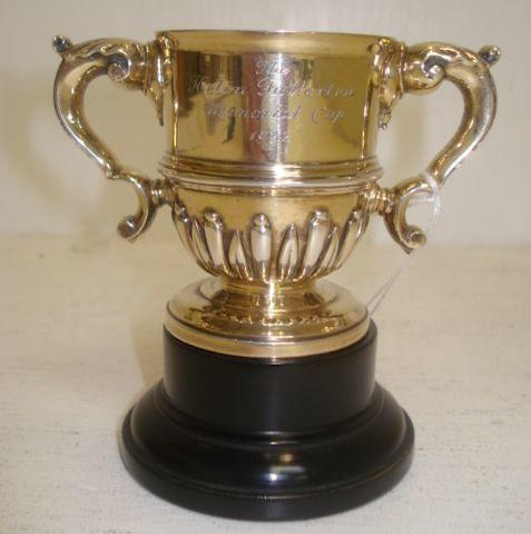 A miniature William & Mary style silver gilt trophy, makers mark rubbed, 1930, of good gauge, inscribed 'The Helen Fullerton Memorial Cup 1932', 6cm, 5ozs, with plinth. (2)
