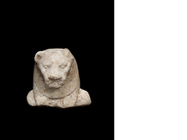 An Egyptian marble fragment of lion-headed goddess