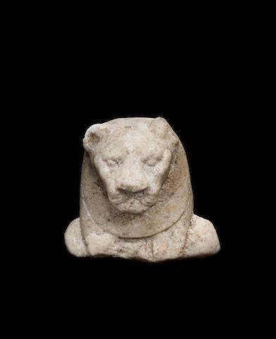 An Egyptian marble fragment of lion-headed goddess