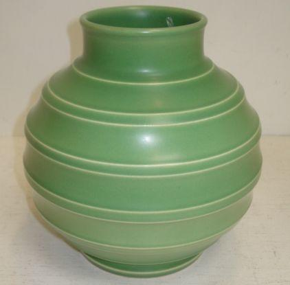Keith Murray for Wedgwood: a green glazed bomb shape vase, 20cm.