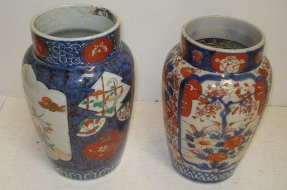 Two Japanese Hizen Imari vases, one painted with panels of quail amongst flowering branches, the other with panels of birds on flowering trees, 25cm.