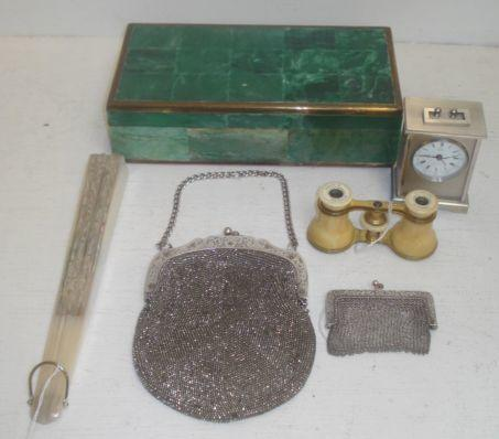 A continental silver chain link purse, early 20th Century, inscribed, an electroplate mounted cut steel handbag of similar period, pair of late 19th Century ivory and gilt metal opera glasses, Duchesse 12 Verres, a similar period fan, with mother of pearl sticks, the leaf with lace painted and sequined in original box, a cigarette box and a timepiece. (7)