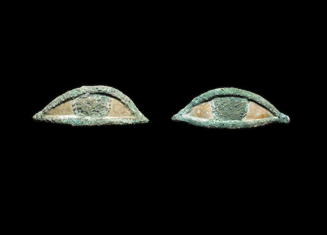 A pair of Egyptian bronze eye inlays