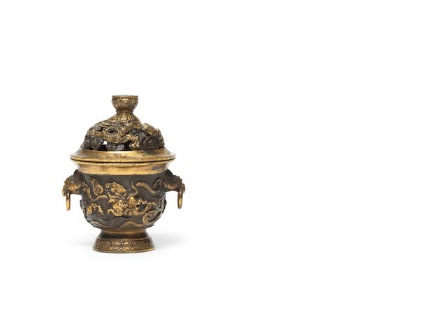 A rare partially-gilt bronze 'dragon and phoenix' incense burner and cover Ming Dynasty, seal mark Daming