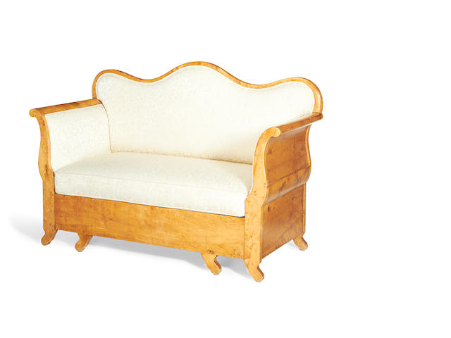 An early 20th century Biedermeier style satinbirch sofa