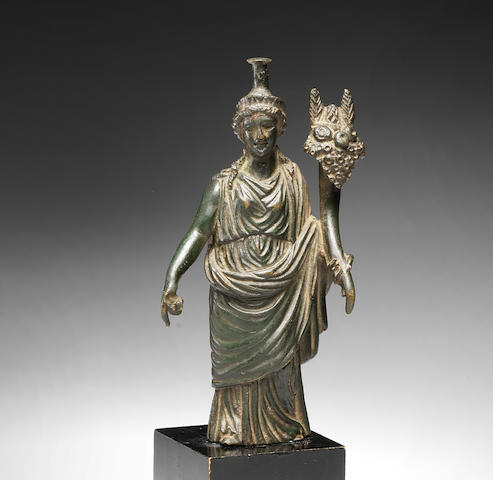 A Roman bronze figure of Tyche-Fortuna