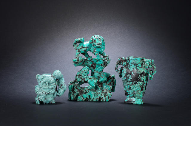 three turquoise carvings