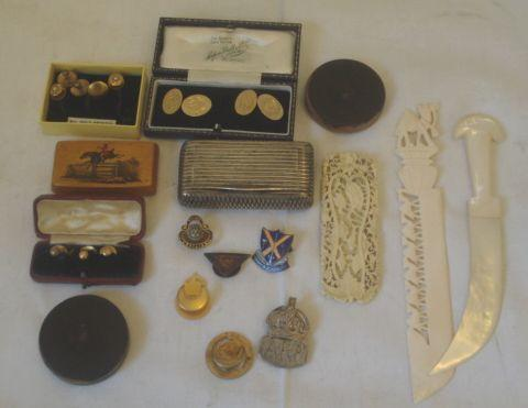 A George III parcel gilt silver snuff box, with reeded and hatched decoration engraved with an inscription 'W H Butler Oxford 1807', a sycamore snuff box with coloured pen and ink horse and rider, silver ARP badge, five other enamelled lapel badges, various collar studs, pair of 9ct gold cufflinks, engraved with initials and two lignum cased wax seal impressions, Chinese relief carved and pierced ivory panel, mother of pearl paper knife.