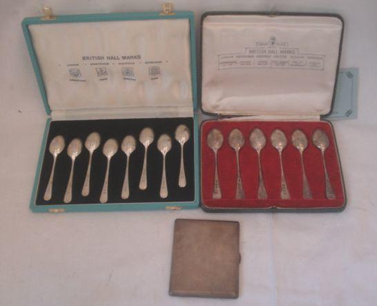 A cased set of eight silver British hallmark spoons, Jubilee mark for 1977, another set of six hallmark spoons, Jubilee mark 1935, an engine turned cigarette case, by Walker & Hall.